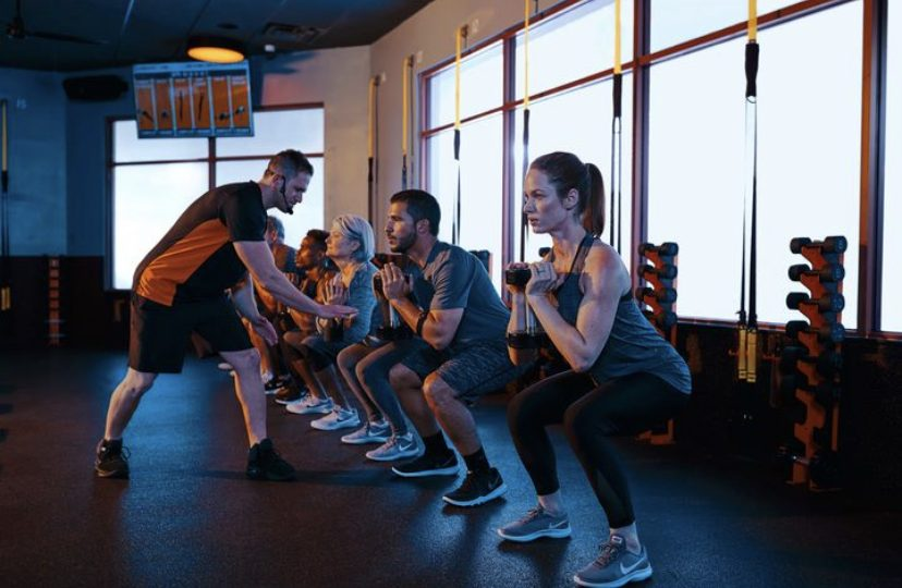 people working out in orange theory fitness victoria